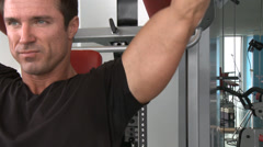 Man doing Shoulder Arm Press at Gym Stock Footage
