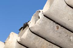 Asbestos cement pipes against the blue sky Stock Photos