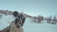 Stock Video Footage of Hunter sees a black moose and points rifle at it.