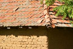 Ud brick rural building and red tiled roof in rural macedonia Stock Photos