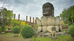 Head of buddha in a lotus flower. monument in ayuthaya, thailand Stock Footage