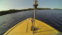 Motor boat driving at a sunny lake Stock Footage