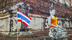 Buddha statue and thai flag in the temple Stock Footage