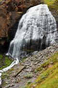 waterfall girlish braids between the mountains of northern caucas - stock photo