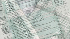 Money on income tax form - stock footage