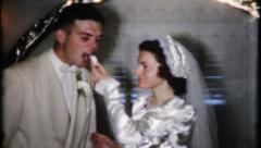 852 - newlyweds share the wedding cake - vintage film home movie - stock footage