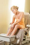 Stock Photo of woman in spa salon having pedicure