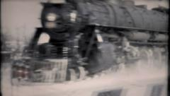 856 - snow does not stop the trains - vintage film home movie - stock footage