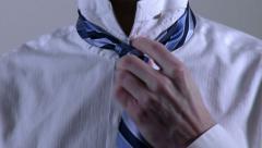 Man Tying Necktie Detail - stock footage