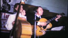 853 - the band rocks the crowd at local event - vintage film home movie Stock Footage