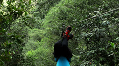 Stock Video Footage of Women on the zip line upside down, bat position, fixed camera