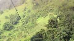 Sounds of excitement while riding a zip line, camera tilts down Stock Footage