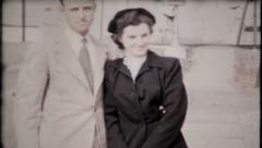 858 - fashionable couple pose for the camera - vintage film home movie Stock Footage