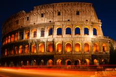 Night shot of the coliseum in rome, italy Stock Photos
