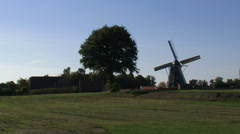 Skyline Dutch countryside + windmill in operation Stock Footage