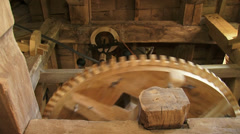 Low angle - interior industrial windmill - wooden cogwheels and the governor Stock Footage