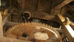 Close up windshaft + zoom out  wooden cogwheels + governor, industrial windmill Stock Footage