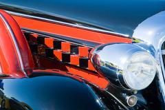headlamp on vintage motor car - stock photo