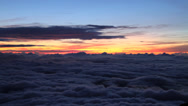 Stock Video Footage of Sunrise Above The Clouds on Mt. Fuji