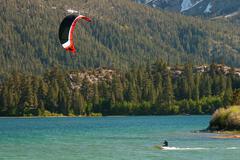 Kiteboarding at june lake Stock Photos