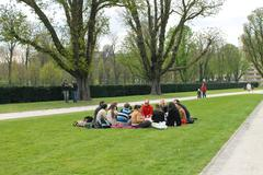 group of youths at a picnic in spring jubelpark  brussels, belgium - stock photo