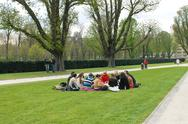Stock Photo of group of youths at a picnic in spring jubelpark  brussels, belgium