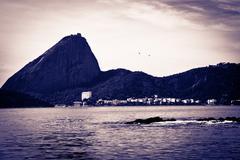 Sugar loaf from a boat at baia de guanabara in rio de janeiro Stock Photos