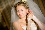 Stock Photo of a bride playes with her dress