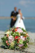 Wedding bouquet, bride and groom. focus on the bouquet. Stock Photos
