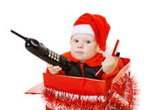 infant calling by phone in the decorated christmas box - stock photo