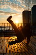 man dancing on terrace - stock photo