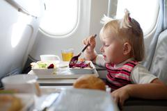 Child eating in the airplane Stock Photos