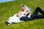 Stock Photo of lovers on the green grass
