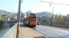 Tram & cycles on a bridge over River Po, Torino Stock Footage