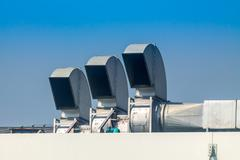 Industrial air conditioning and ventilation systems on a roof Stock Photos