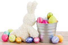 fluffy easter bunny with eggs - stock photo