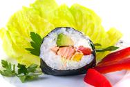 Stock Photo of one piece of sushi on decorated plate