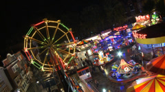 Stock Video Footage of Fun Fair at Night Aerial View