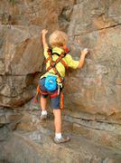 young rock climber - stock photo