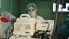 Anesthetist, anesthesiologist monitoring EKG monitor,close up. Stock Footage