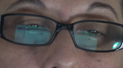 Mature Woman Browsing The Internet Reflection In Her Glasses Front-Shot Stock Footage