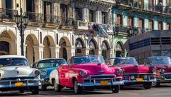 Caribbean cuba havana vintage cars in row Stock Photos
