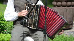 Accordionist man play rural folk music with accordion Stock Footage