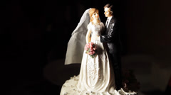Figurine of bride and groom on the cake Stock Footage