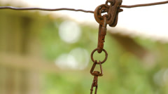 Old, rusty chain on green background close-up Stock Footage
