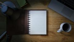 Work desk with notepad opening for notes Stock Footage