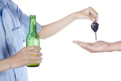 alcoholic giving a car key to someone - stock photo