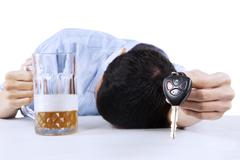 alcoholic offering a car key - stock photo
