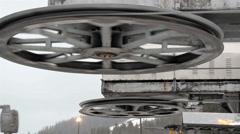 Closer look of huge roller pulleys Stock Footage
