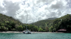 Stock Video Footage of St. Lucia sailing  016 reach a small bay with catamaran